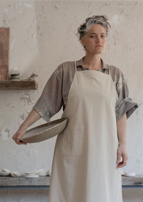 The thales apron is designed as a functional piece for all types of studio work. it has a minimal a-line silhouette. the apron can be worn loose for a ease of movement or tightened via ties around the waist. the ties themselves can be tied up in multiple ways.    ¦ 100% cotton.  ¦ long ties that can be tied multiple ways.  ¦ naturally crinkled cotton.  ¦ designed and made in canada.  ¦ machine wash cool on delicate or gentle cycle only.  ¦ wash with like colours inside out. do not bleach. dry fl