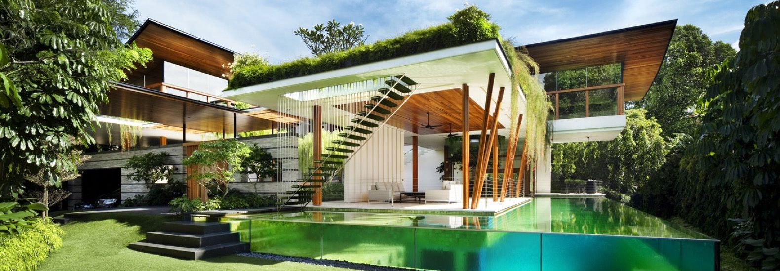 This breezy greenroofed home in Singapore embraces nature from all