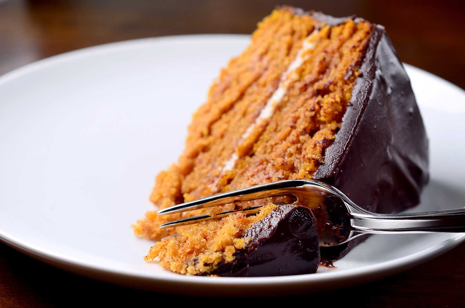Pumpkin cake with chocolate ganache is the best cake recipe for Fall! This perfect pumpkin cake is layered with cream cheese frosting and it is SO good!