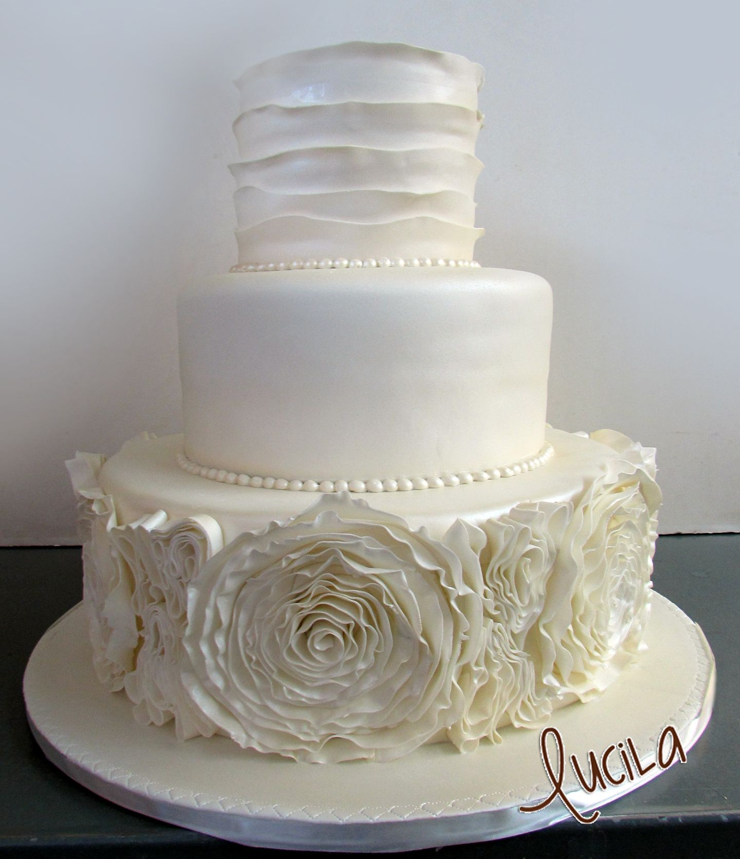 Three tier wedding cake showing a stylish trendy design Wedding