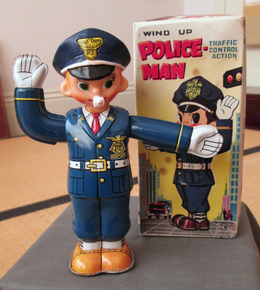 Nomura Wind up Policeman Tin toy from 50s ebay