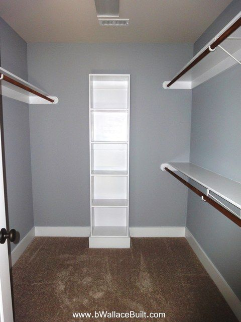 Walk In Closet In The Master Bedroom Many More Shelves And A Small Folding Cabinet In Mid Of Room Closet Remodel Modern Closet Diy Walk In Closet