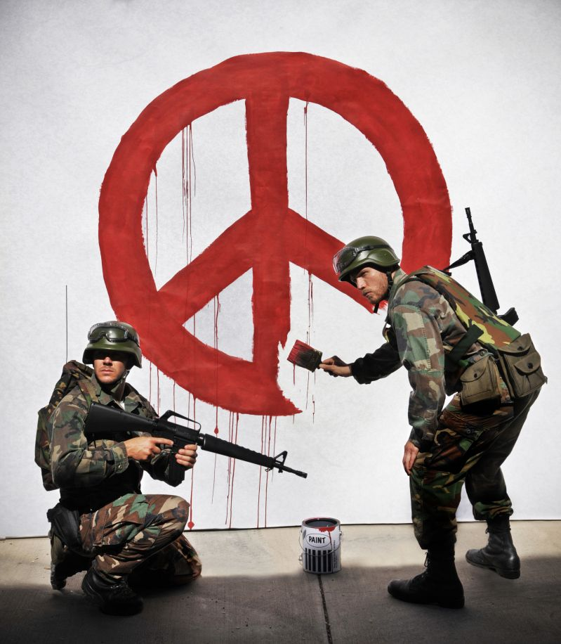 Banksy's soldiers painting peace sign - recreated. 1. What's the big deal? 2. What does this image say about our world?  3. What does this image say about peace and war?