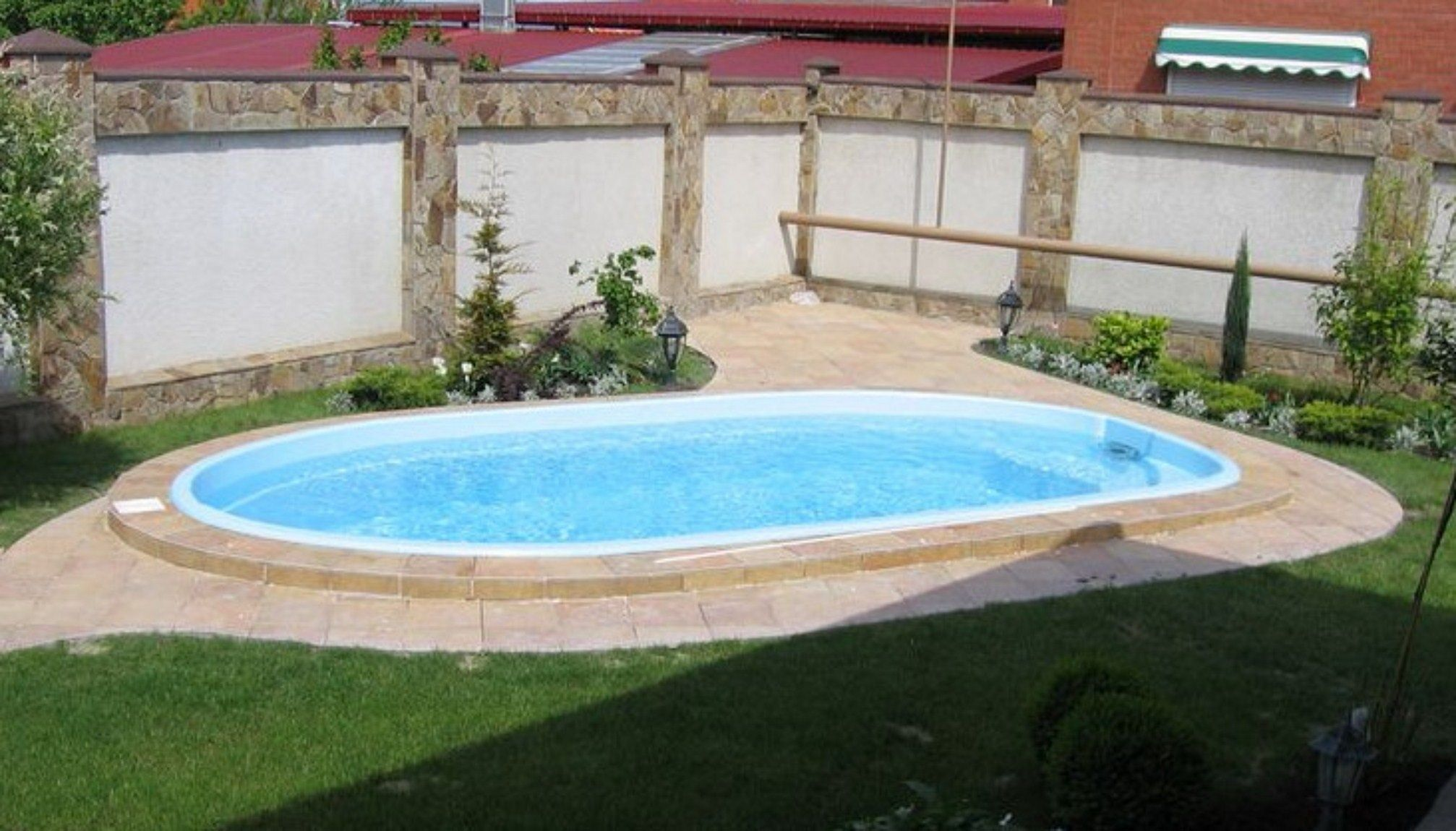 25 Top Oval Above Ground Swimming Pools Design with Decks ...