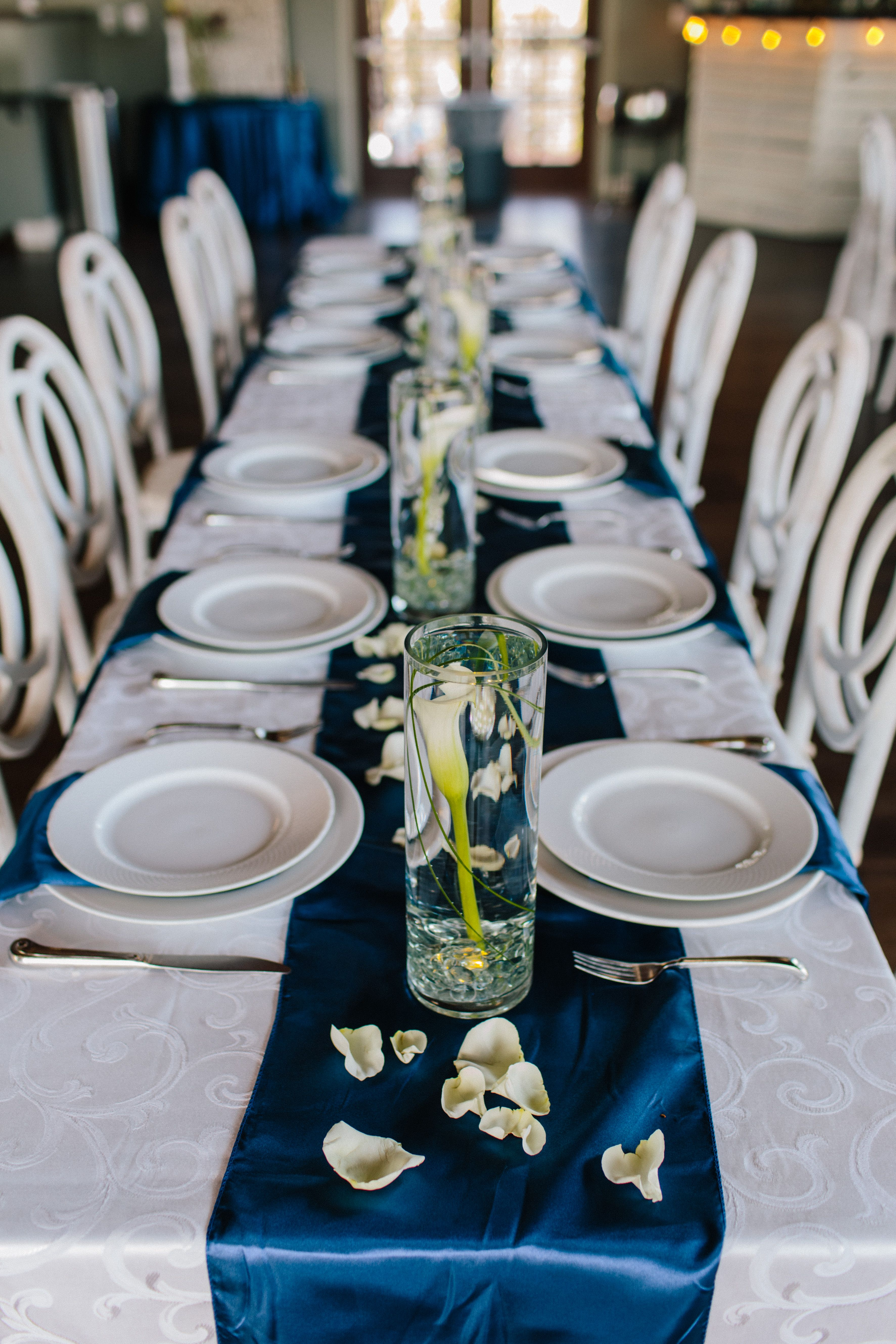 Ivory and blue wedding reception. Photo by Christina Hastings Photography