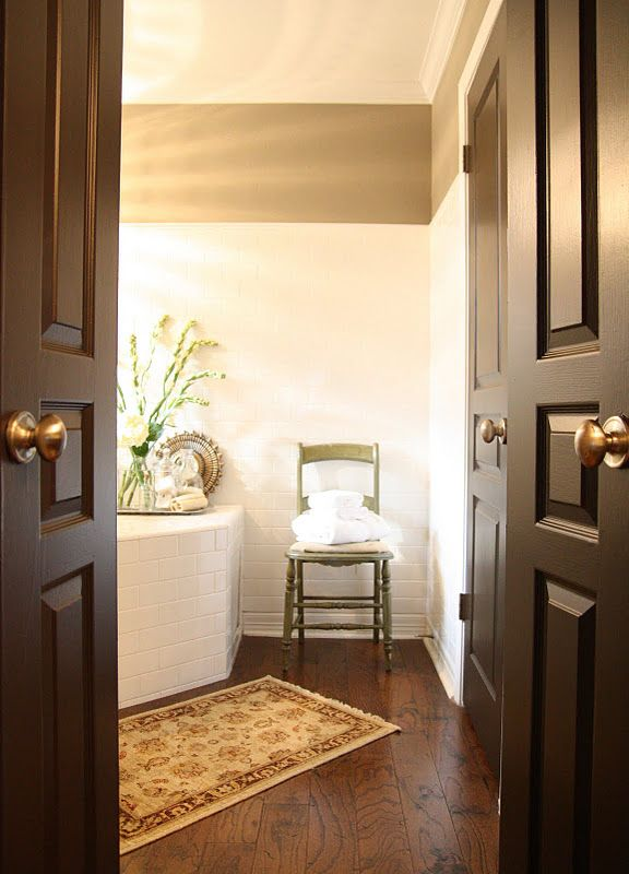 Builder Basic Becomes Less Boring With Deep Brown Painted Doors With White  Trim