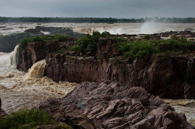 During monsoon period, India ,Raneh falls. During monsoon period, India ,  Sea shell. On a backgrou