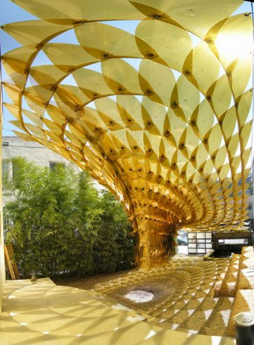 Creating spaces with a minimum of material- The temporary outdoor installation 'Maximilian´s Schell' – a featherweight shade structure, which casts beautiful, colored fractal light patterns onto the ground –an impressive example of this strategy