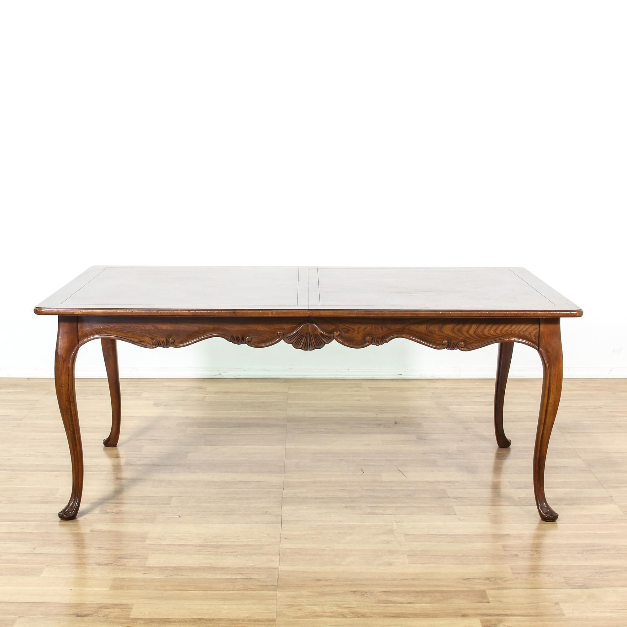 This french provincial dining table is featured in a solid wood