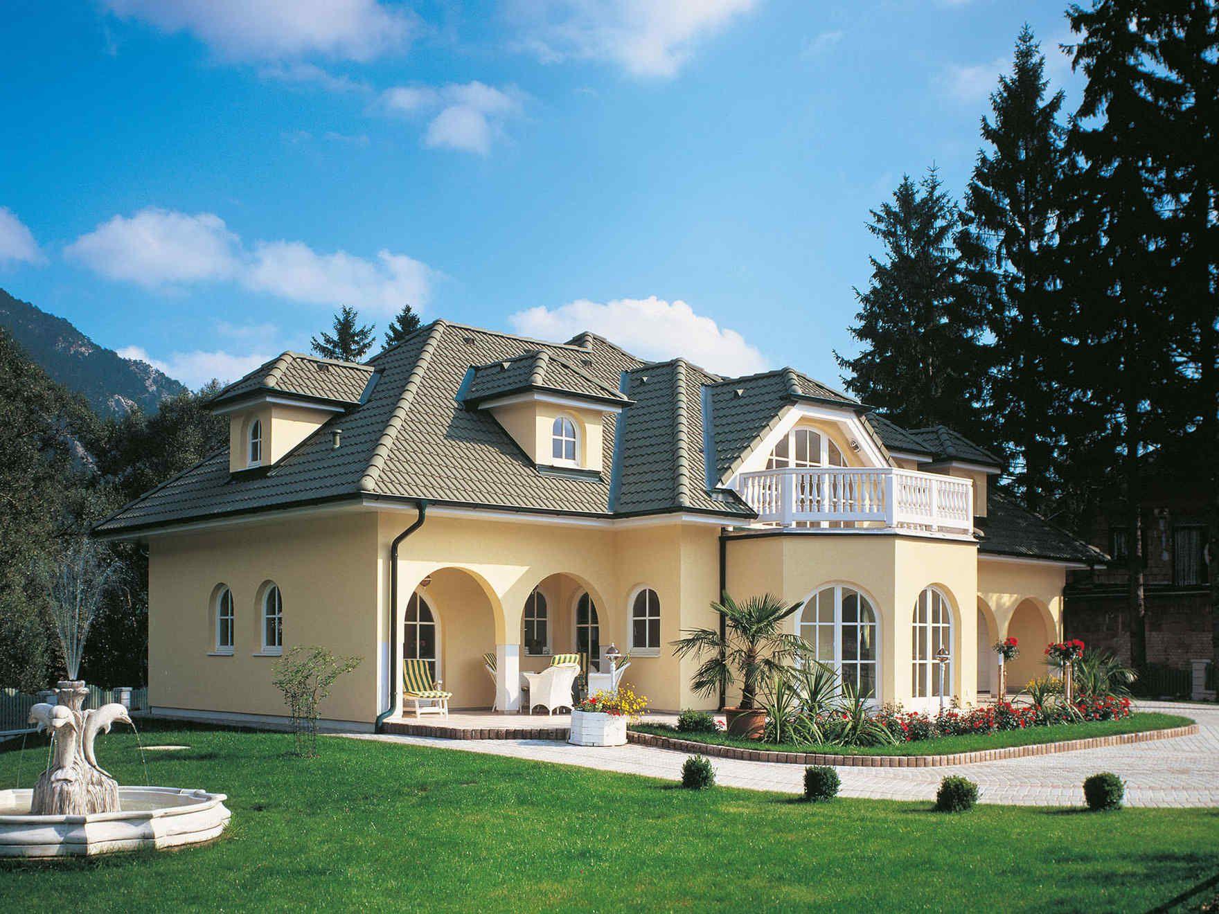 Das Fertighaus VARIO HAUS Exclusive 261 ist nach einer klassisch harmonischen Architektur konzipiert Ein Fertigteilhaus gebaut als Niedrigenergiehaus