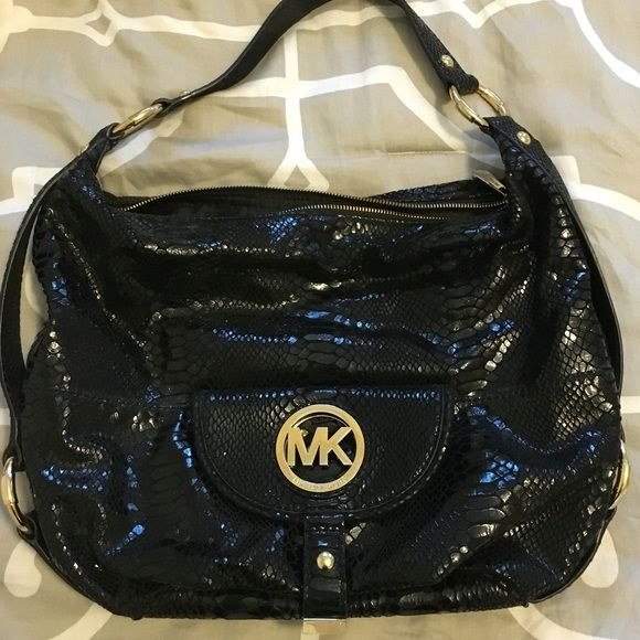 Snakeskin MK Bag Black snakeskin Michael Kors bag with gold hardware. The MK  logo on the front has minimal scratches from normal wear. 0fce478cb3fd0
