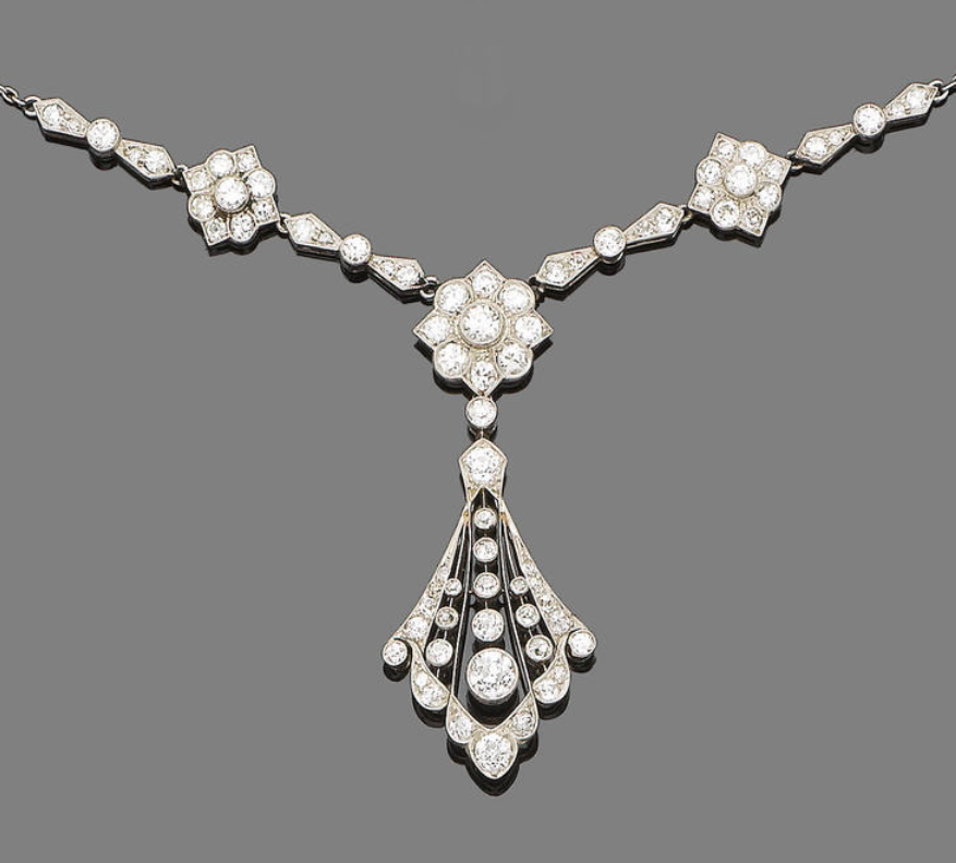An early 20th century diamond pendant necklace, circa 1910  Set to the centre with three old brilliant-cut diamond flowerheads, interspersed with similarly-cut diamond bows, terminating in a fan-shaped pendant finely pierced and millegrain-set with old brilliant-cut diamonds, diamonds approx. 3.00ct total, lengths: necklace 44.2cm, pendant 3.6cm, fitted case by Edward & Sons Ltd, 93 Buchanan Street, Glasgow