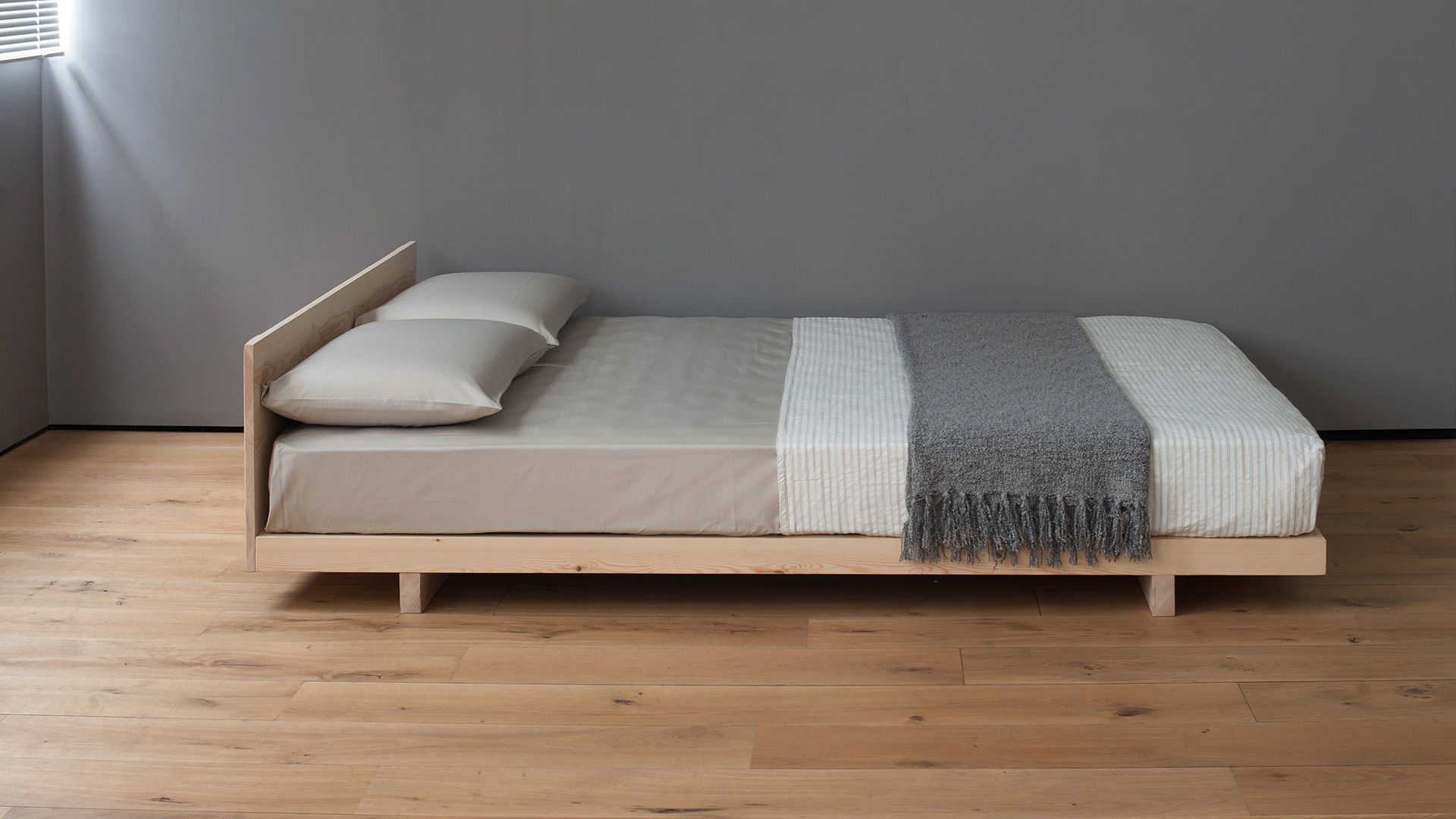 A simple stylish Japanese bed with headboard