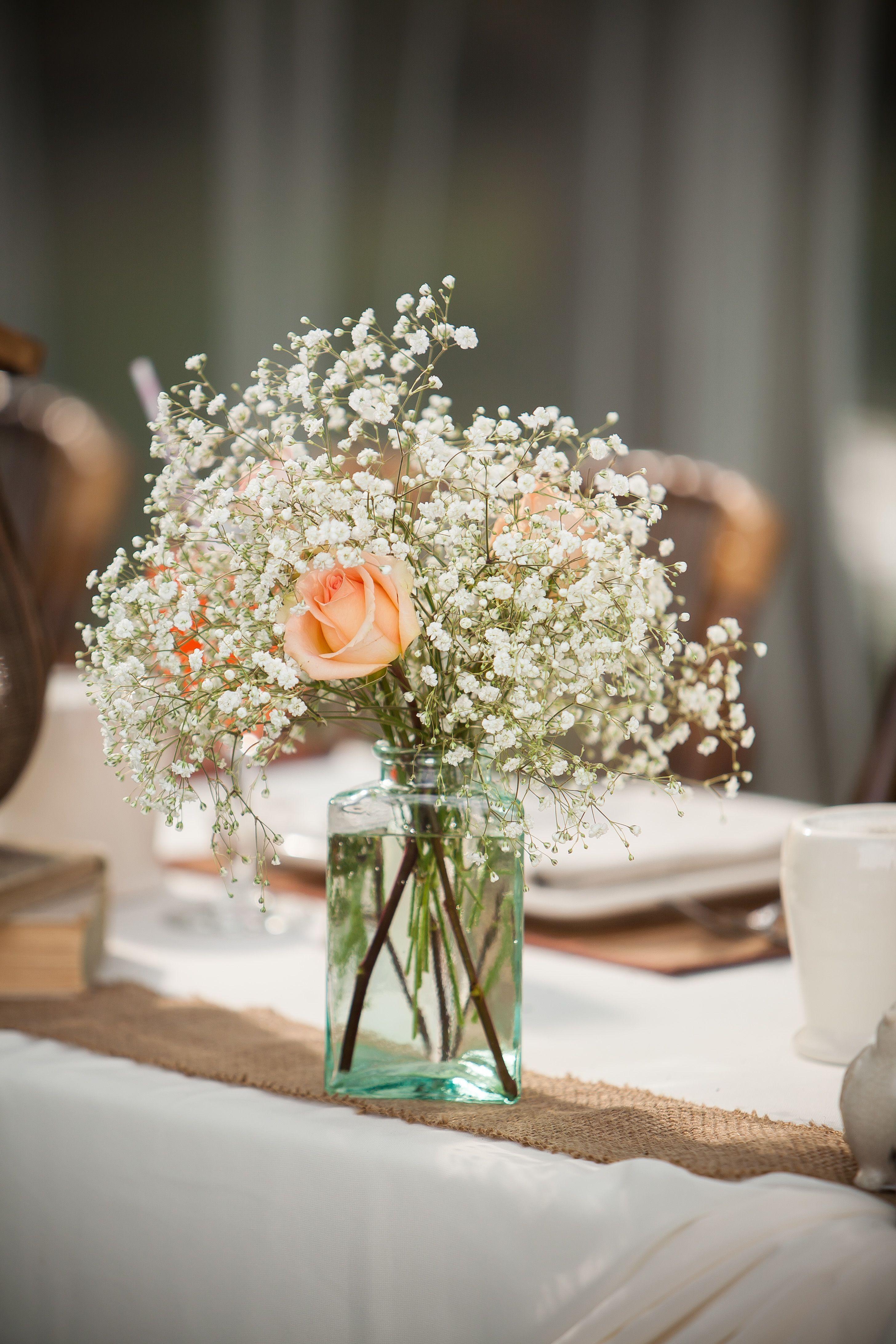 Peach Rose And Baby S Breath Centerpiece Wedding Reception Flower Arrangements Flower Centerpieces Wedding Table Flower Arrangements