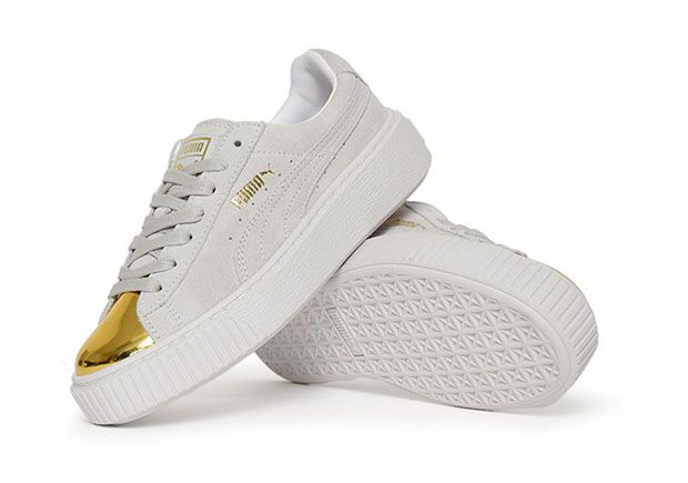 white and gold puma shoes
