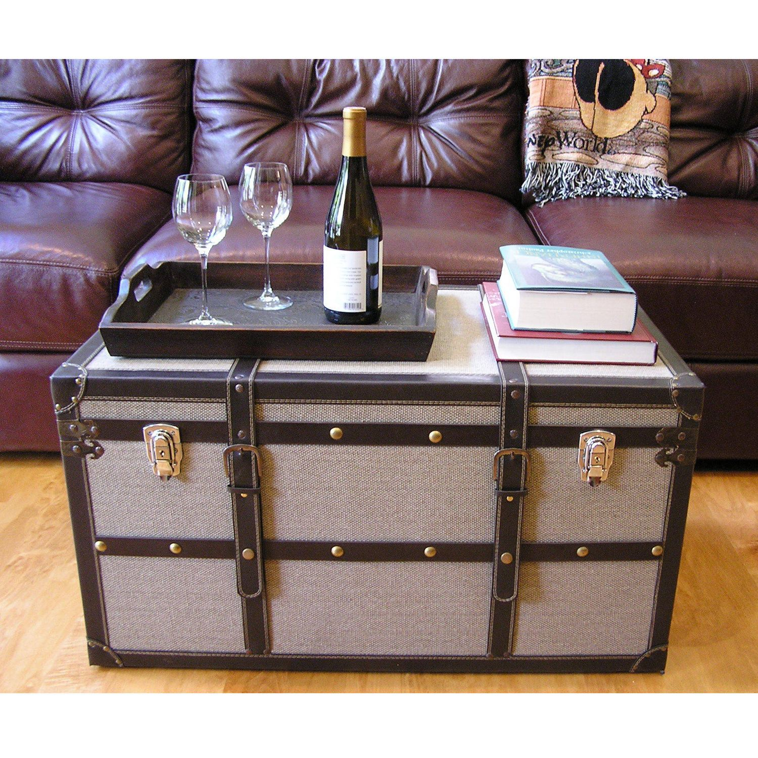 This beautiful wood trunk features old fashioned hardware for an