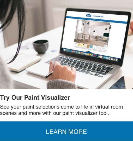 a woman uses the paint visualizer tool on the computer to on lowe s virtual paint a room id=52156