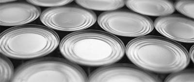 Sell by and Use by dates stamped on canned food
