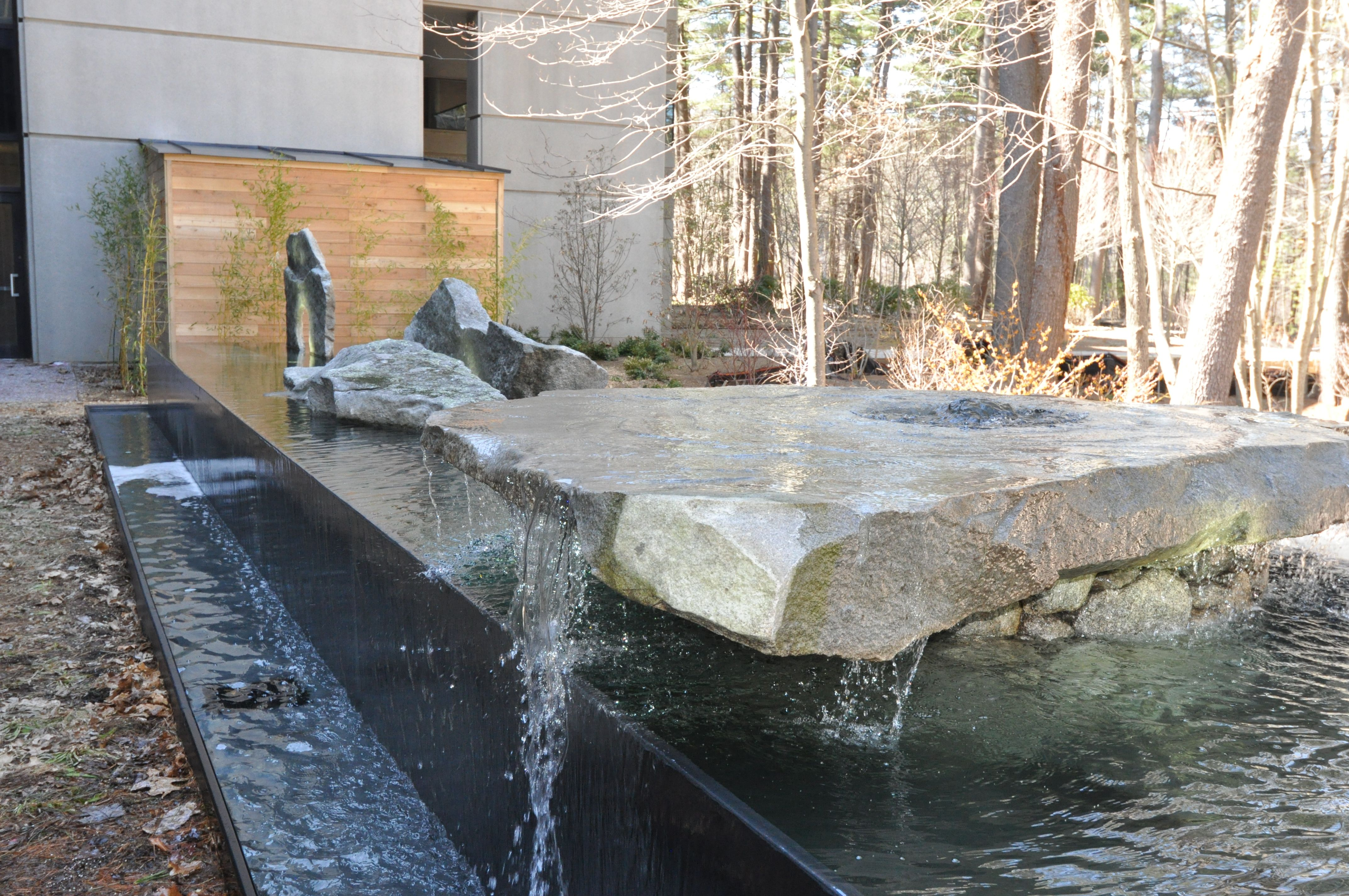 The Edge Bedford >> Negative Edge Water Feature With Found Art Stones Oracle