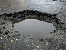 The Milder Than Normal Winter Means A Smaller Pothole Crop This Year On City Streets Officials Say Potholes Normally Cost The City About Take Care Of Yourself Door County Take Care