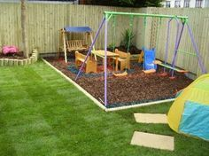 sodded edged with wood and wood chips for kids play area