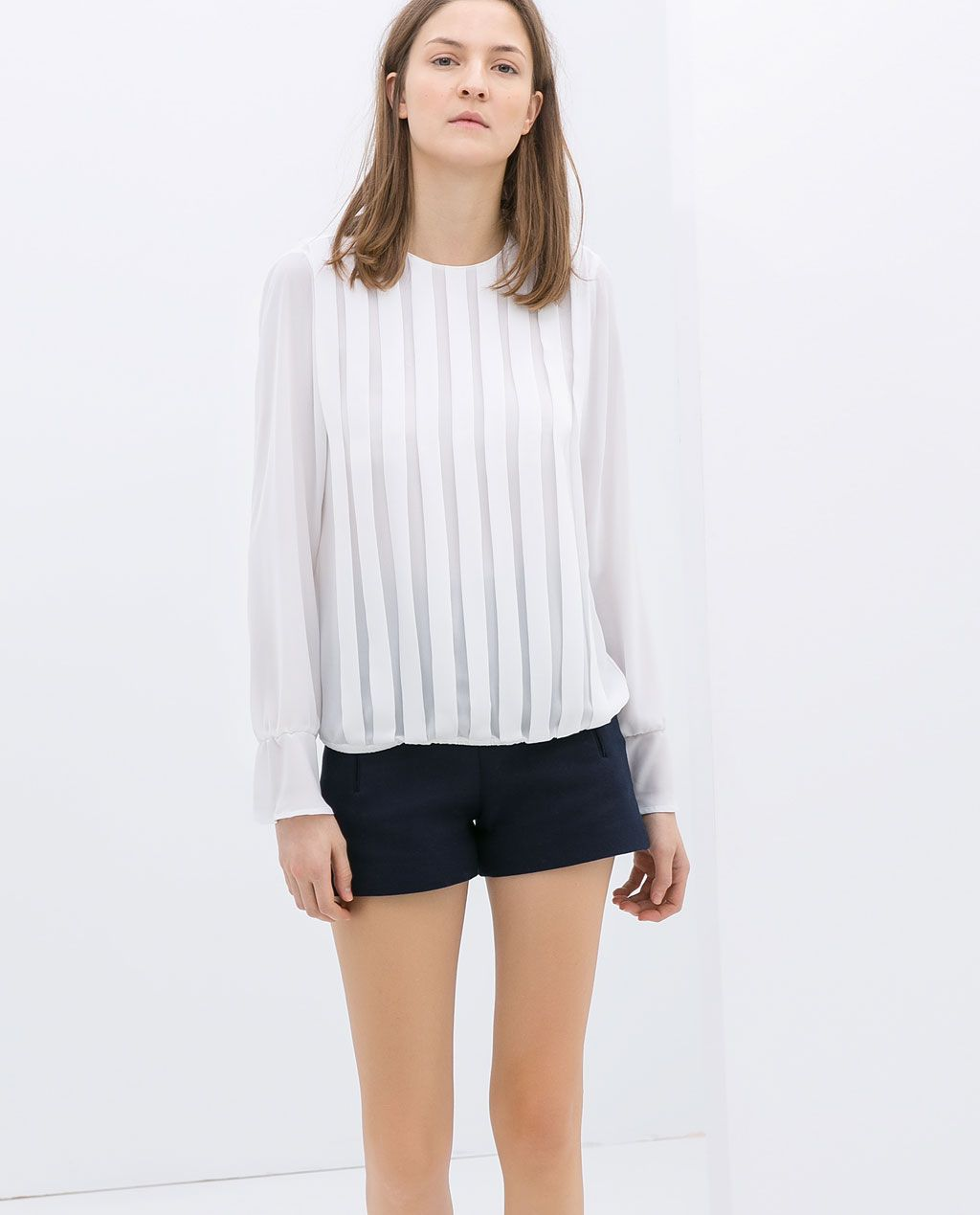 Image 1 of BLOUSE WITH RUFFLES ON THE FRONT from Zara 10e | Basics ...