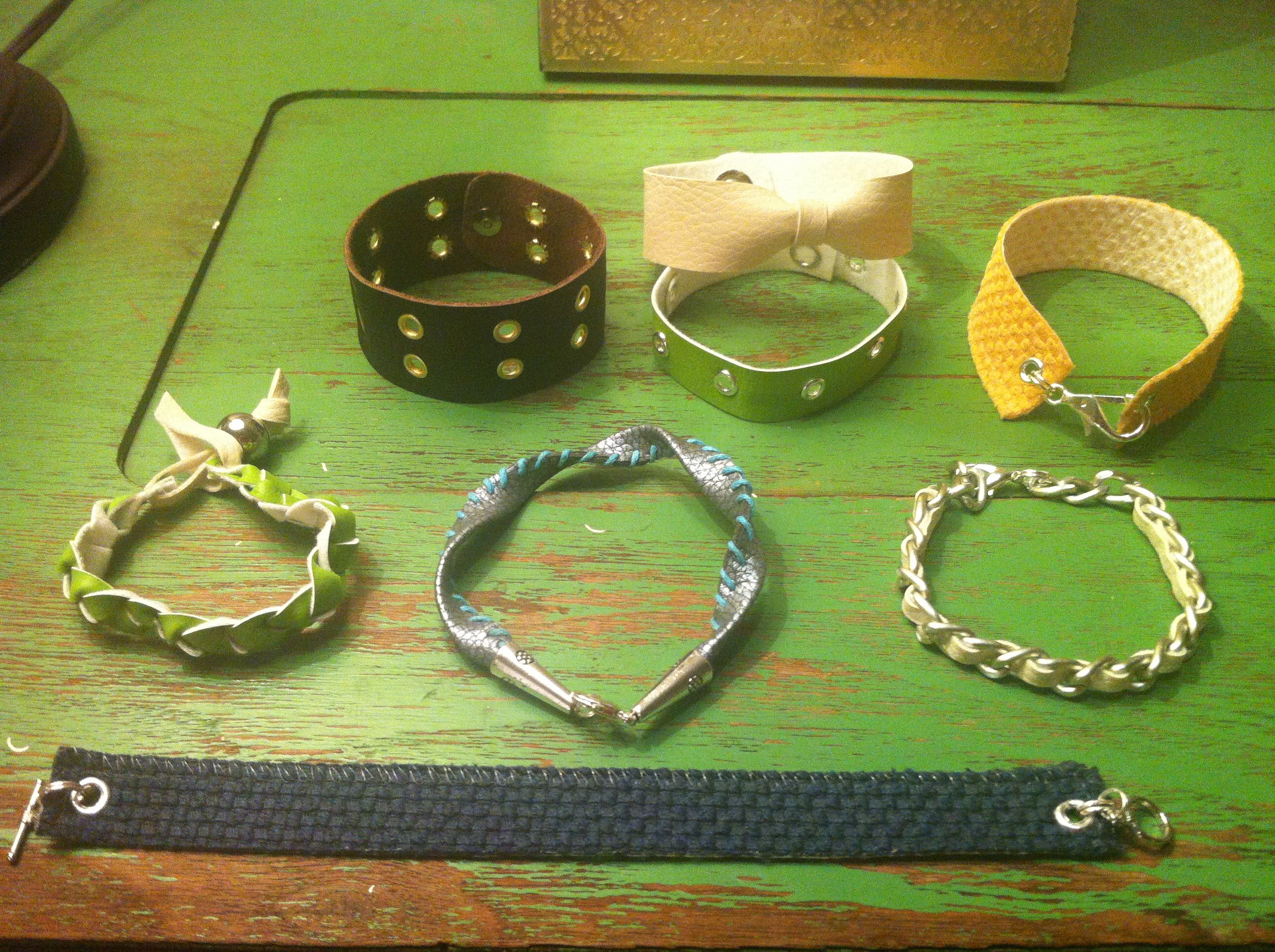 Leather, vinyl and fabric bracelets made from upholstery scraps. I mined pinterest for ideas, shopped Micheal's and Joann's for jewelry clasps and chains and made these over the weekend. Mix and match!
