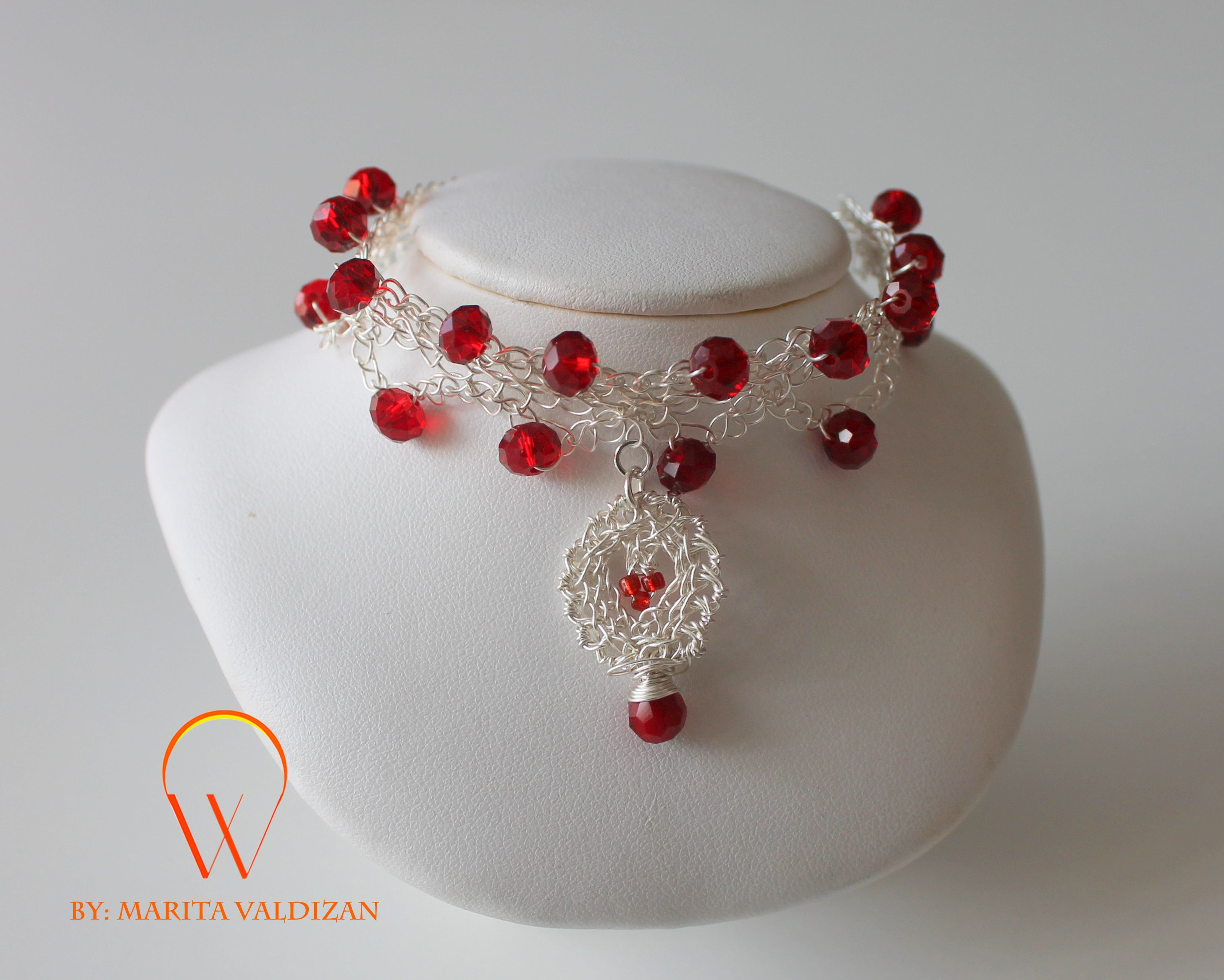Love in the Air Bracelet. Beautiful wire crochet bracelet with red crystals.