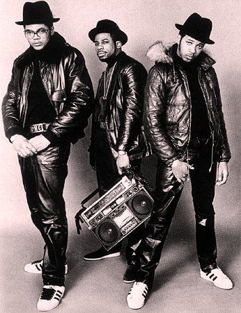 Run DMC + Jam Master Jay.I swear I see this picture & can hear Rock Box &  Sucker Mc's in the background.