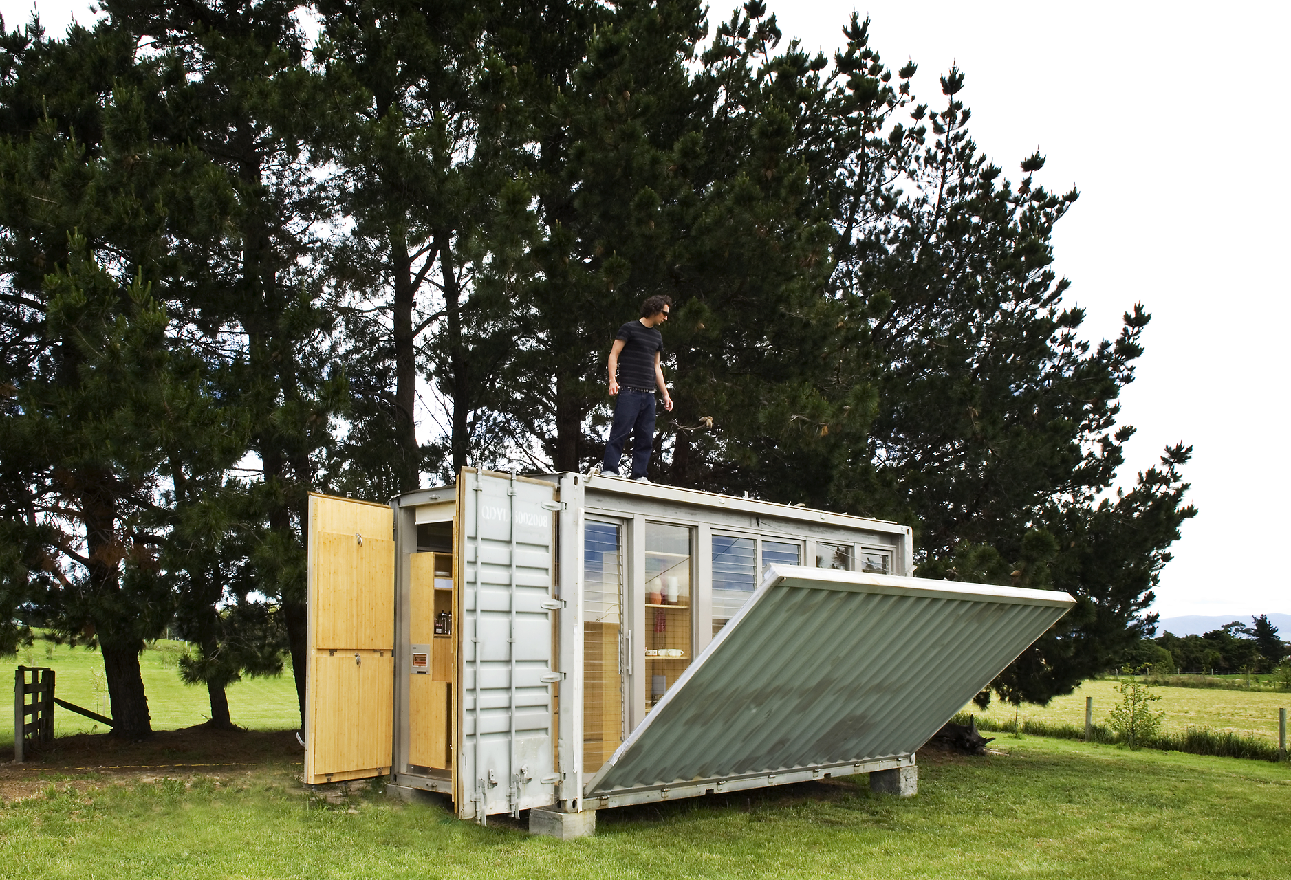 tiny container home complete with retractable deck |