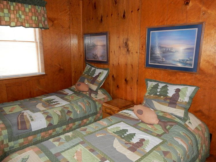 Another bedroom in this lakefront home in lake