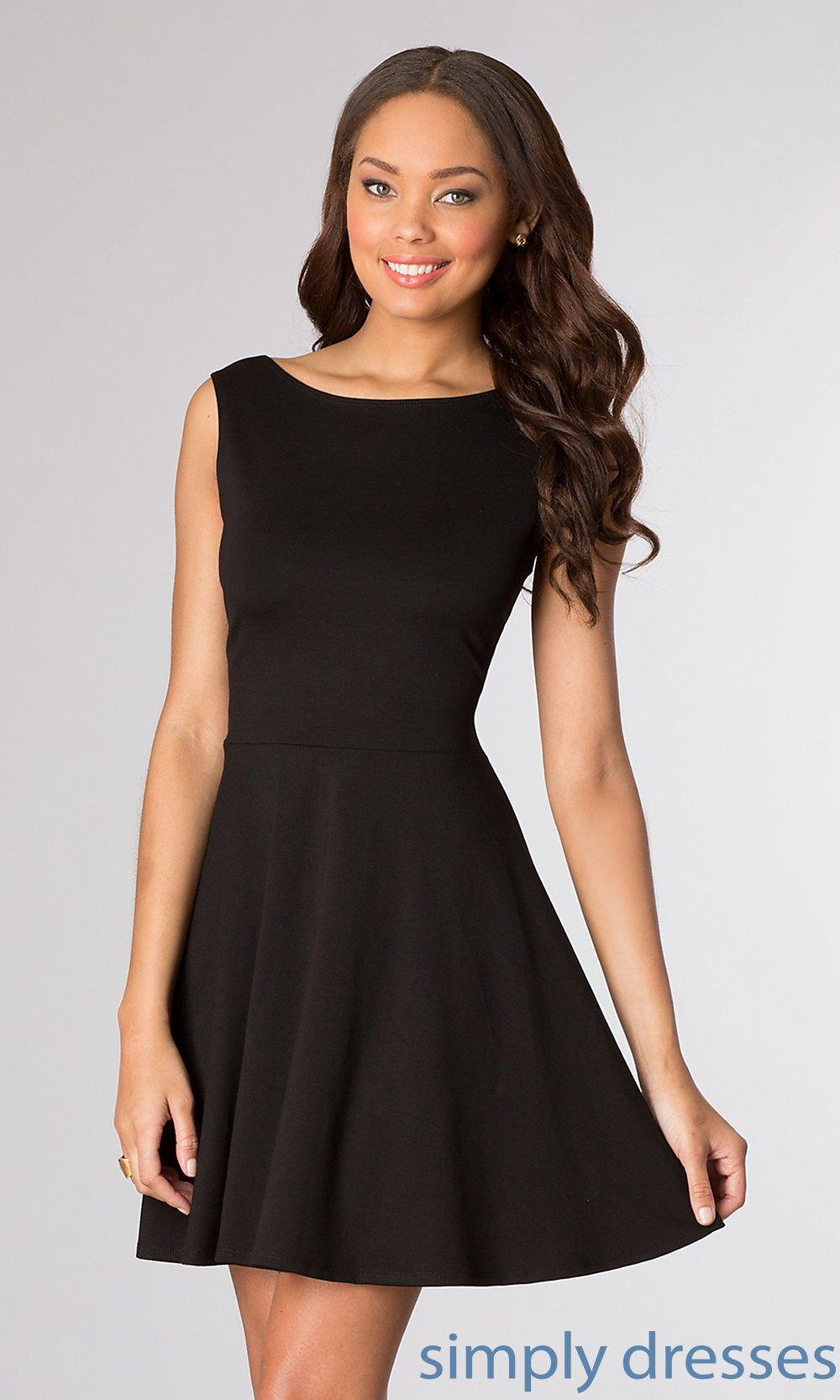 f1d913992c2 The chic and playful short sleeveless little black dress has a high neck  and when you turn around