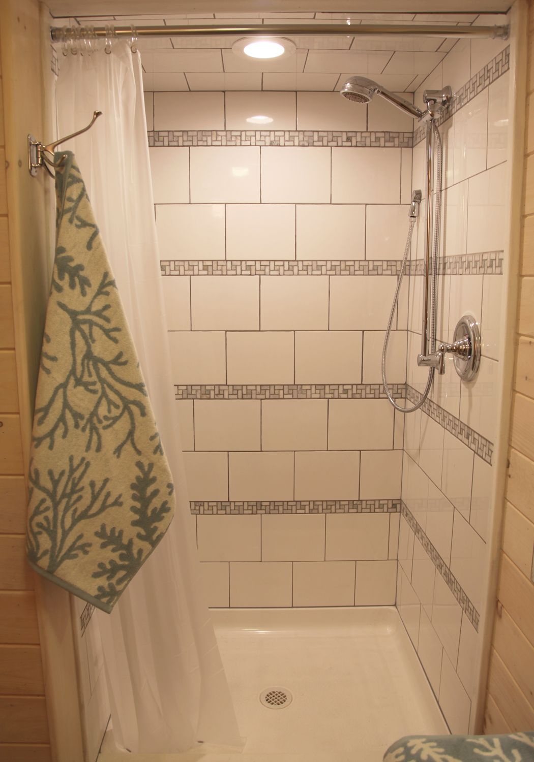 Shower With Horizontal Stripes Of Biltmore Stone Mosaic