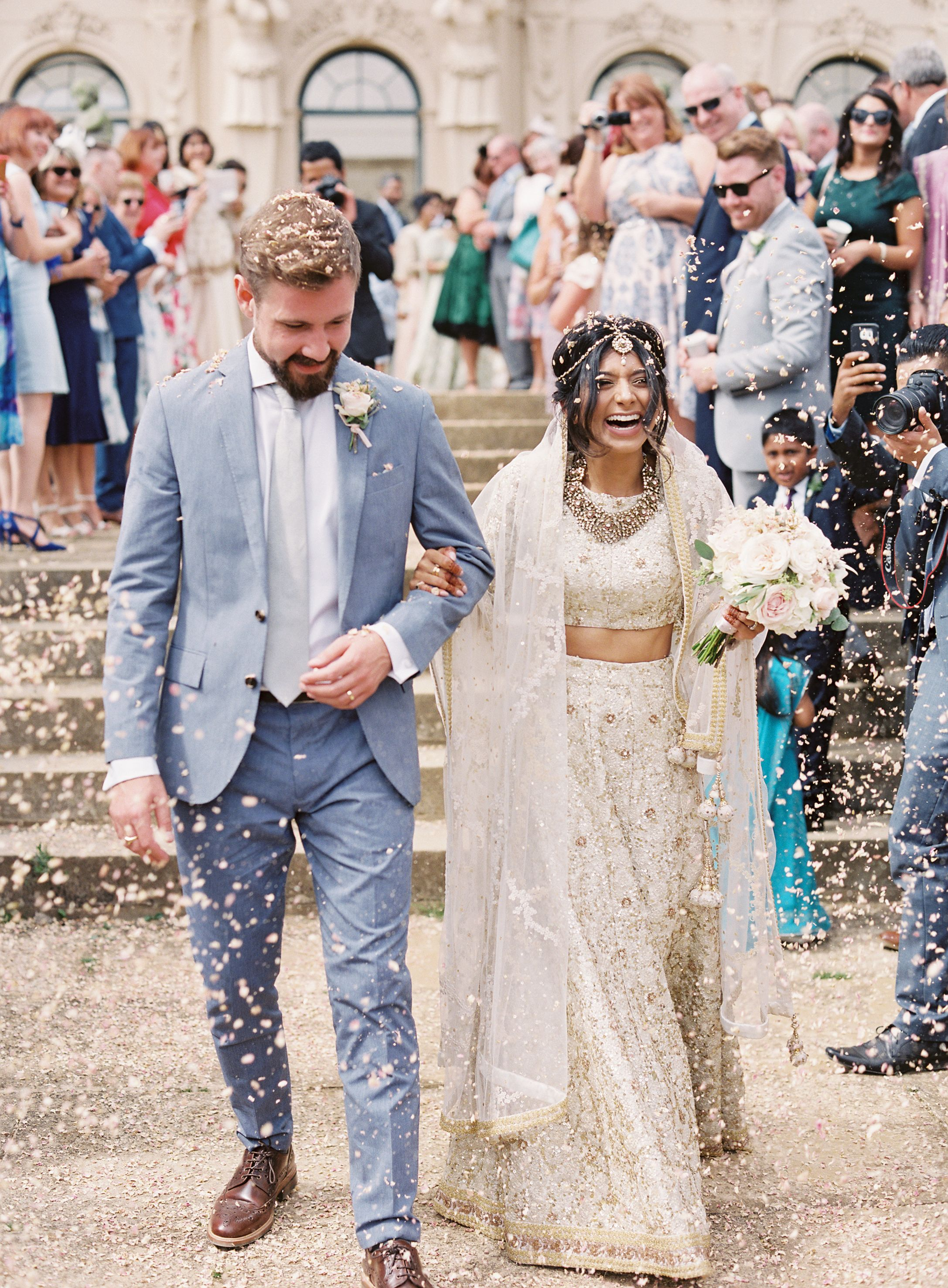 Elegant interfaith wedding with two ceremonies in the english elegant interfaith wedding with two ceremonies in the english countryside beautiful wedding recessional with flower petals on the happiest bride and junglespirit Images
