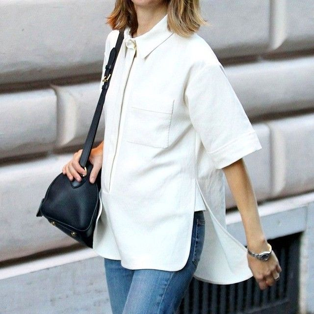 Sofia Coppola // leather bag, side split shirt & jeans #style #fashion #celebrity