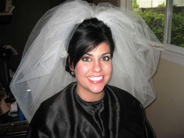 Bridal hair and make up. Love the big veils!