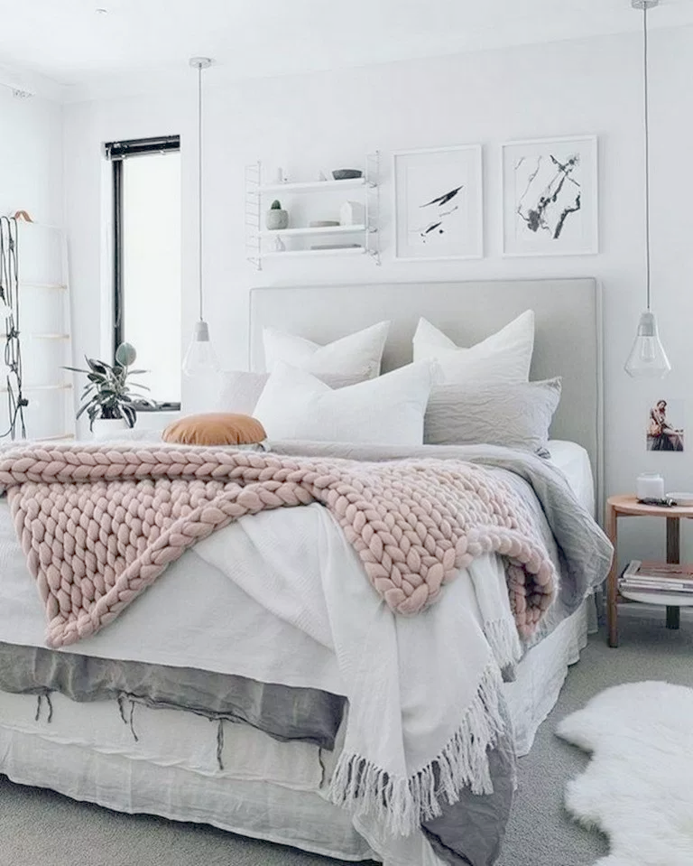A focused shot at this primary bedroom's cozy bed surrounded by white walls and dark hardwood floors. Home Decor Accessories Trends 2019 Below Shabby Chic Easter Decor Pinterest Until Shabby Interior Design Bedroom Small Master Bedrooms Decor Luxurious Bedrooms