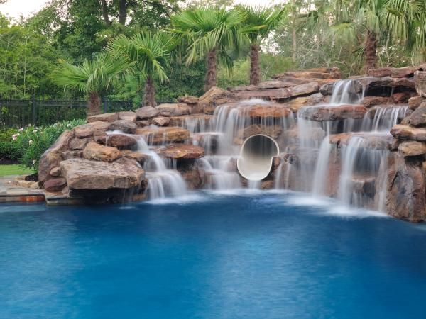 love all the rocks and waterfalls along with the tube slide swimming pool caves and pool cave slides platinum pools - Swimming Pools With Waterfalls And Slide