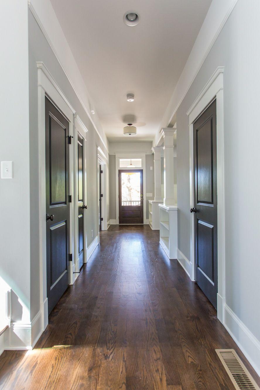 Dark Gray Doors Dark Stained Floors Light Gray And White Walls Light Grey Walls Grey Doors Grey Walls