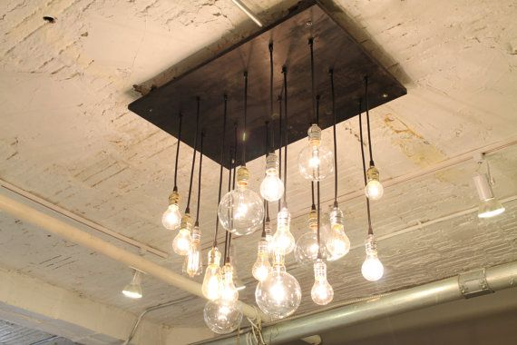 (via Industrial Chandelier with vintage bulbs by urbanchandy on Etsy)