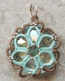 West Pine Creations: flower bauble  _ very pretty, it shows how she made the two sides then joined them around the stone.  Love the colors!