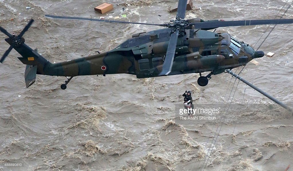 In this aerial image, isolated local residents are rescued by a Japan Ground Self-Defense Force helicopter after the embankment of the Kinugawa River collapse caused flooding on September 10, 2015 in Joso, Ibaraki, Japan. The swamped area stretched up to four kilometers from west to east and 18 kilometers from north to south. About 20,000 buildings, including houses and stores, are located in the affected area.