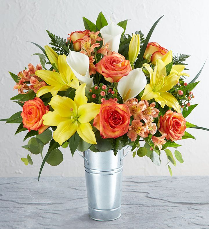 Flowers of farmfresh varieties like bicolor orange roses