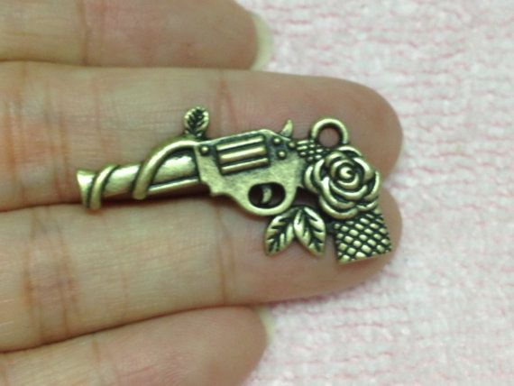 10pc Antiqued Bronze Gun and Rose Revolver by pepperlonely11, $6.99