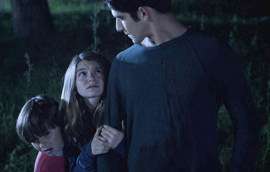 Two frightened kids cling to Scott after being saved from Boyd.