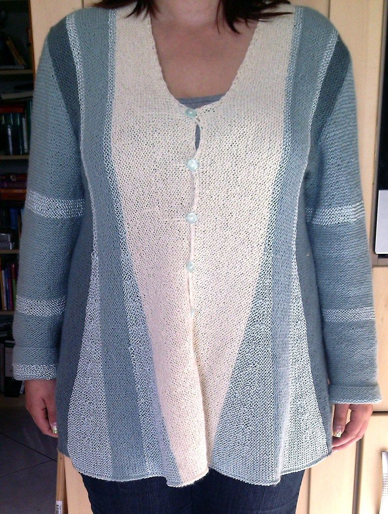 Free Knitting Pattern Pleated Jacket - This garter stitch cardigan features flattering panels that flare at the hips. Size S – XXXL. Pictured project by SpinningWitch