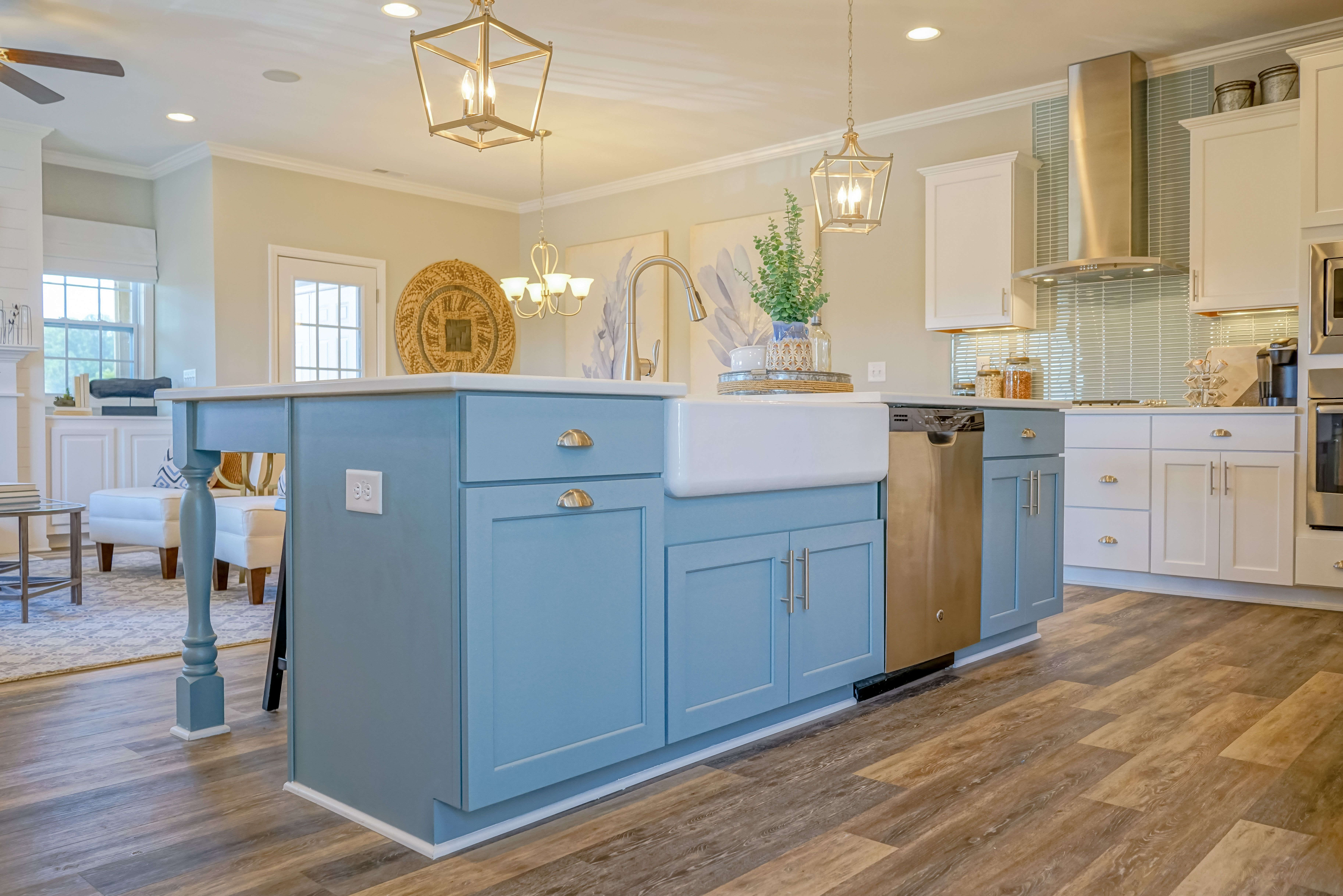 Blue cabinets and white countertops in a kitchen | "|7303|4874|?|en|2|0411f65fb693d485590fa39d8e953ad9|False|UNLIKELY|0.31407010555267334