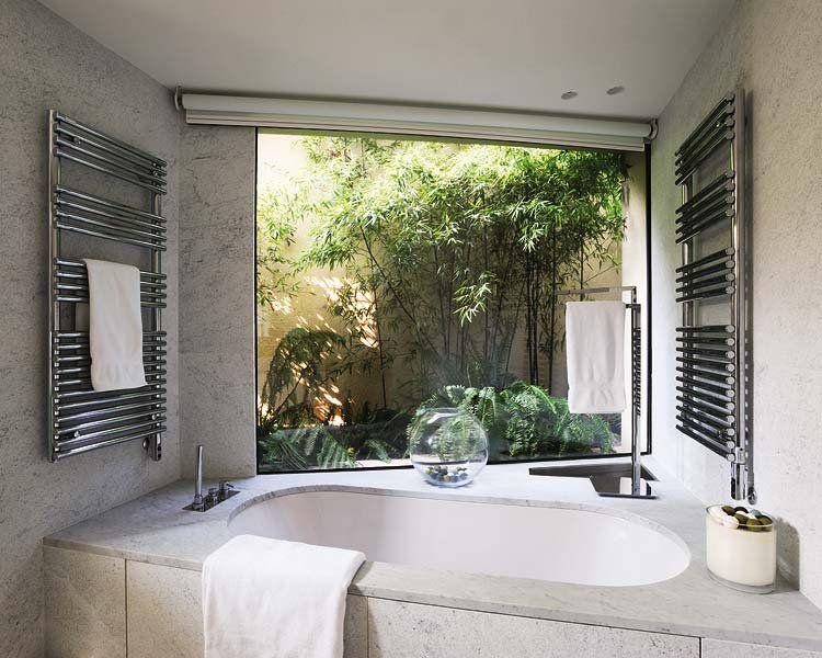 un mirador privilegiado la vivienda limoncello de On banos con jardines interiores