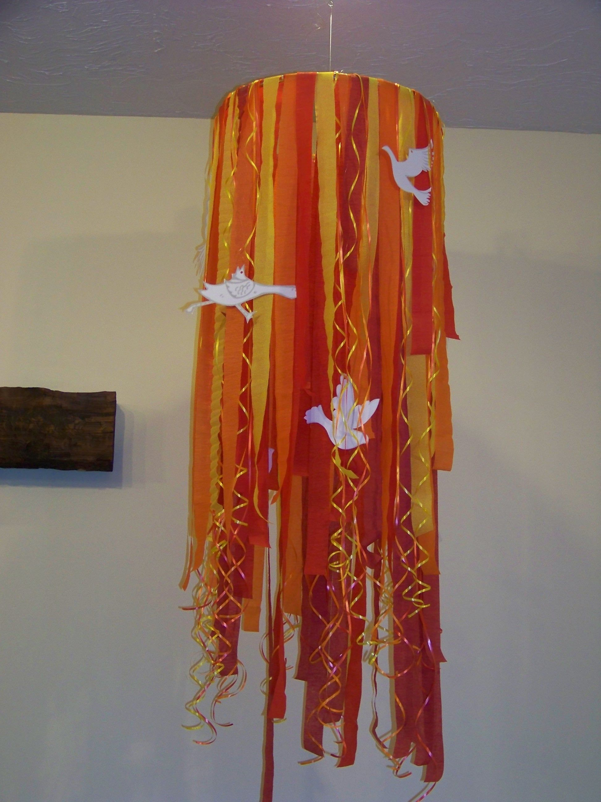 Pentecost Flames for Sunday Service . . . made with a small hula hoop, fishing line, crepe paper streamers, curling ribbons & card stock cut out doves.
