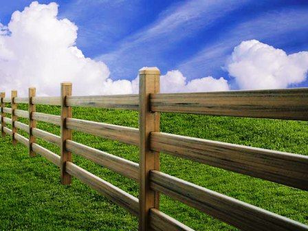 ranch style fencing  front  house driveway gate